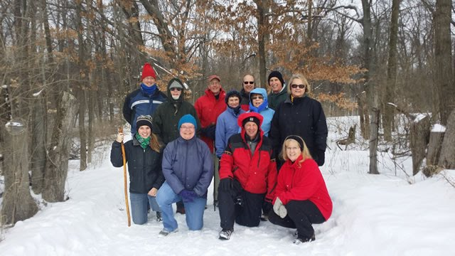 Hikers posing for photo in the snow