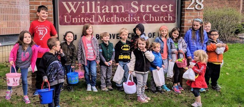 Kids outside at an Easter Egg hunt