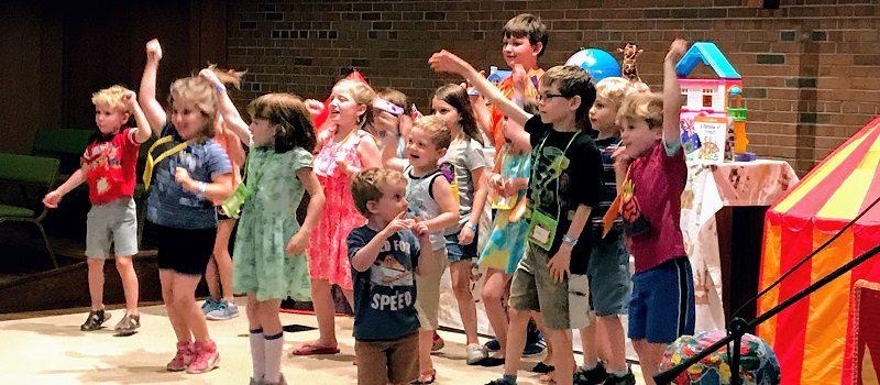Kids dancing during Vacation Bible School